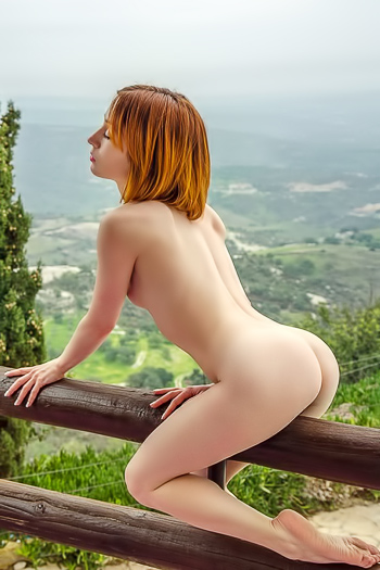 Redheaded schoolgirl takes her uniform off outdoors