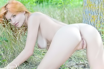 Seriously sexy redhead naked out in the forest