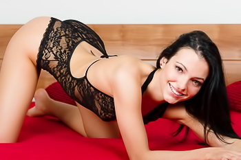 Having fun in bed both in and out of her lacy lingerie