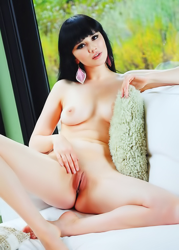 Black haired hottie gently teasing her shaved pussy