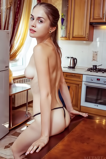 Getting out of her tiny g-string in her kitchen