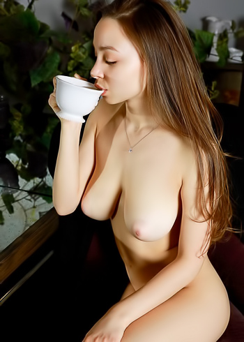 Chesty hottie gets naked for her afternoon tea