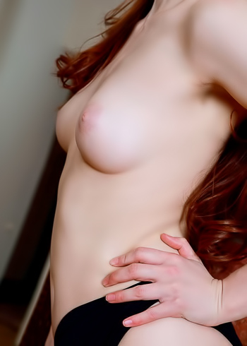 Red haired barely legal cutie getting naked at her house