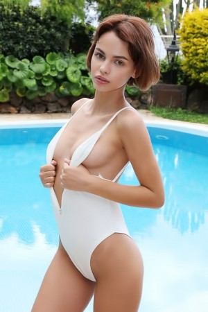 Naked and turned on by the pool